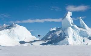 Helicopter flying over the Antarctic.