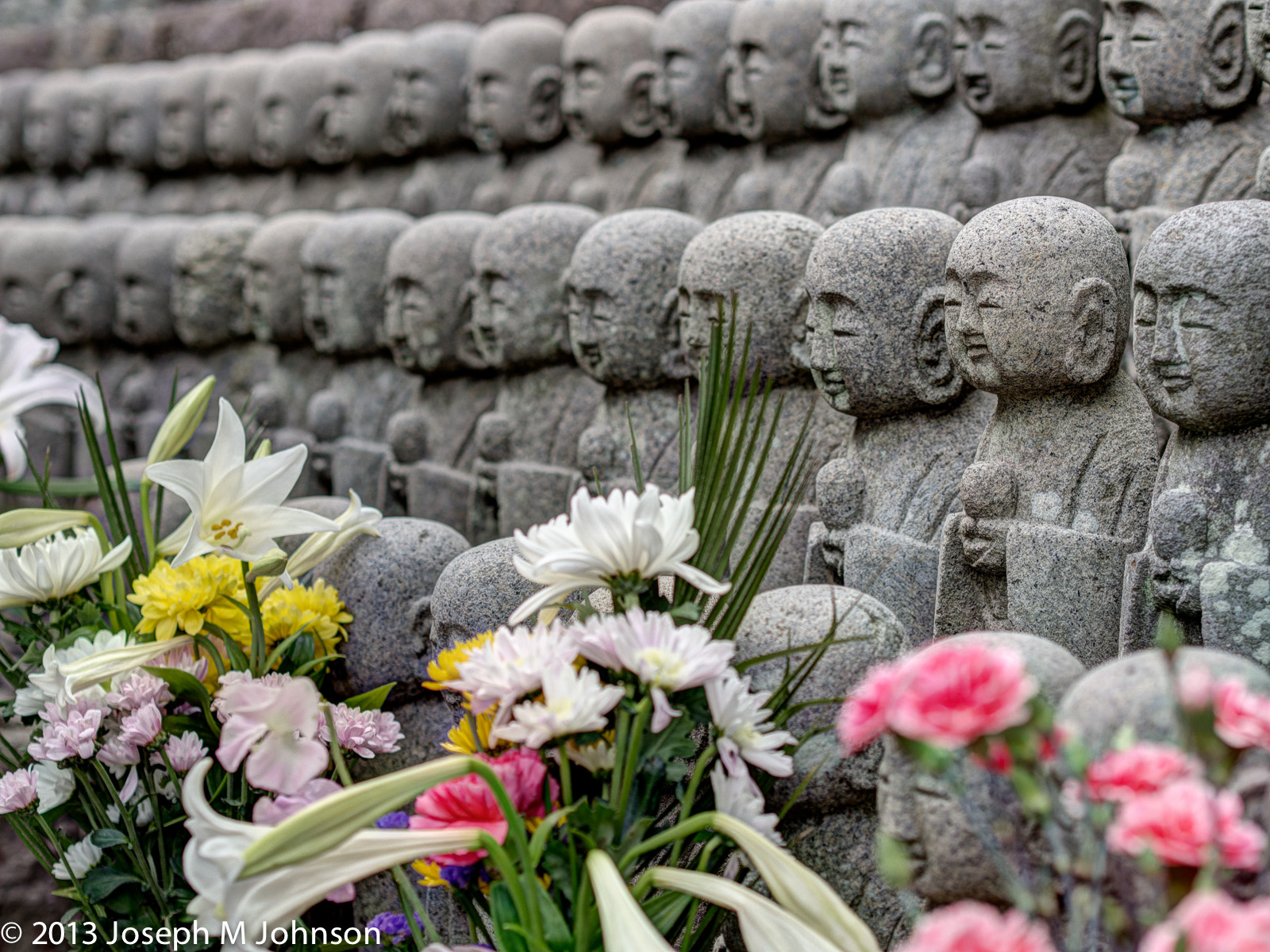 Hasedera Budha statues wth flowers